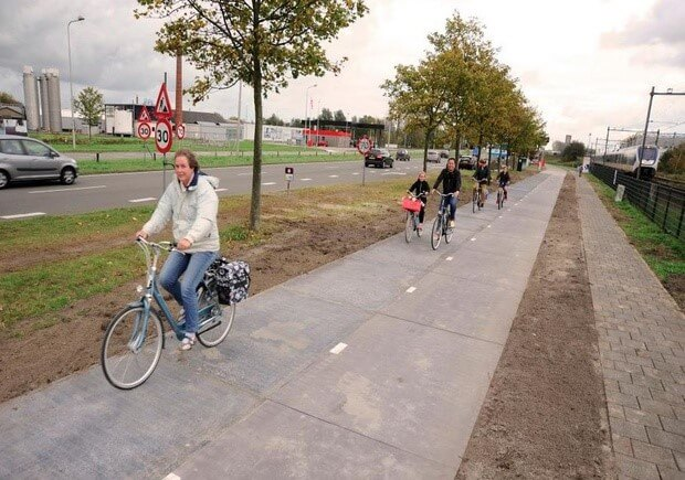 Netherlands cyclists riding on solar powered bike path