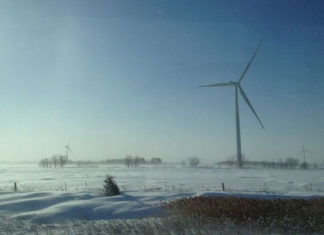 snowy wind turbines in Canada