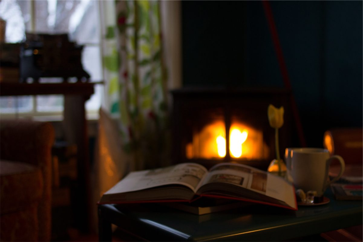 book in front of fireplace